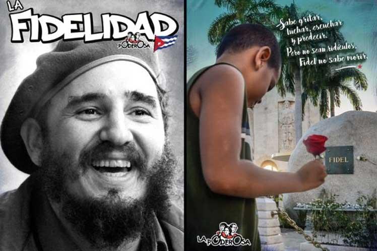 Imagen de Fidel y de un niño poniendo una flor en Santa Ifigenia